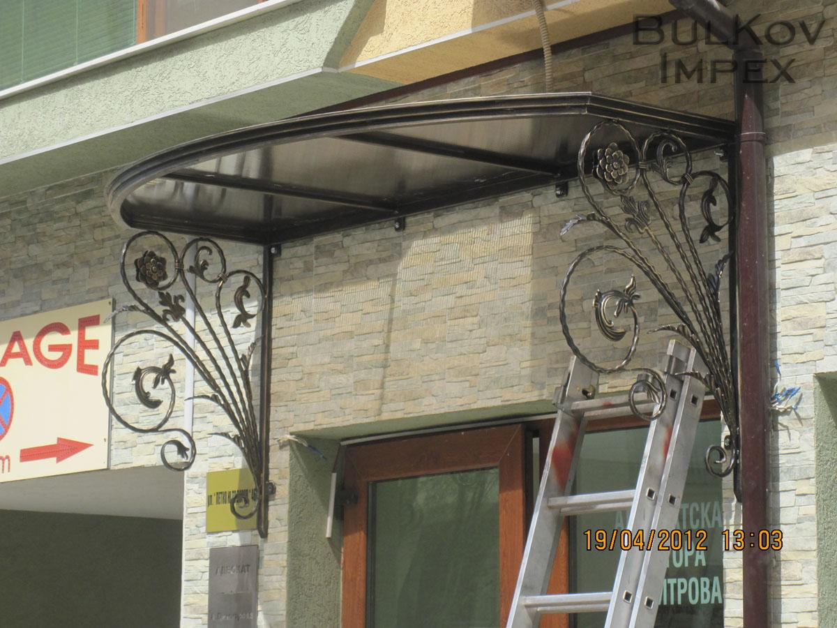 Awning With Wrought Iron Elements And Polycarbonate Surface