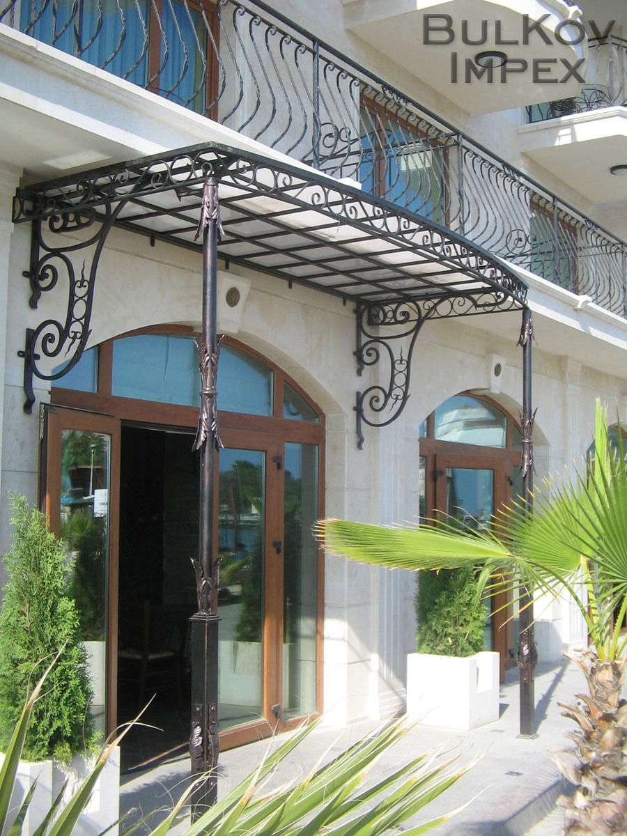 Wrought Iron Awning With Decorated Columns